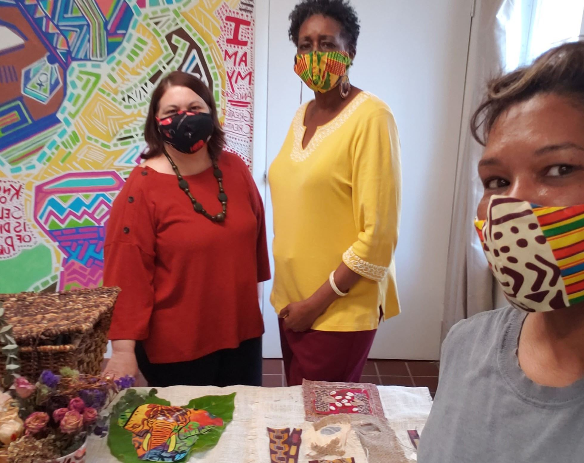 Three Women in Masks with Art Project