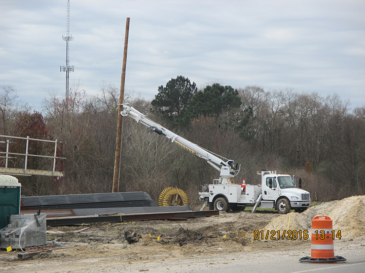 012516_ATT pole being installed on west side of Bilbo Canal wall.jpg