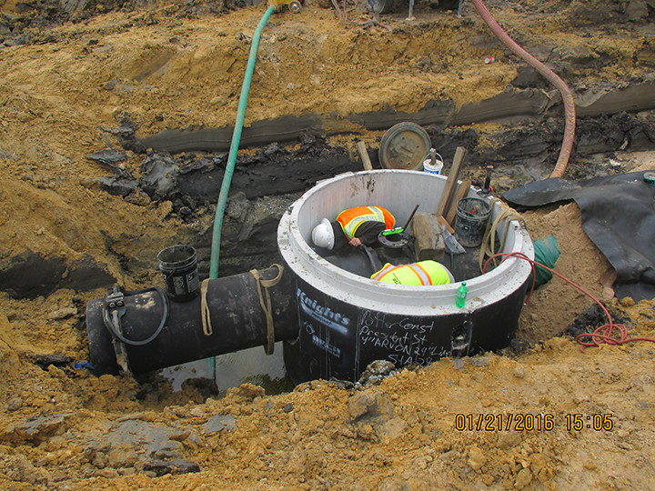 012516_Air Realease Valve being installed in manhole on west side HTP.jpg